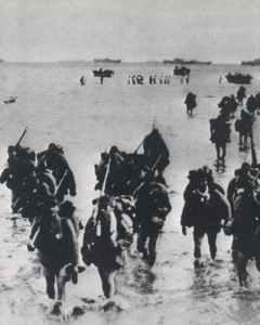 Japanese troops walk ashore.
