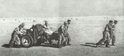 German paratroopers pull gun through the desert