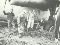 Trying to dig out a B-24 Liberator from mud