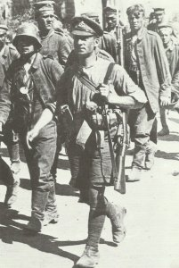 British private wearing shirtsleeves, shorts, cap and puttees