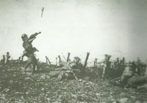 soldier throws a stick grenade