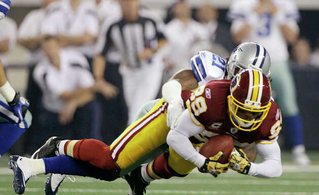 Dallas Cowboys cornerback Mike Jenkins tackles Washington Redskins wide receiver Santana Moss - The Boys Are Back blog