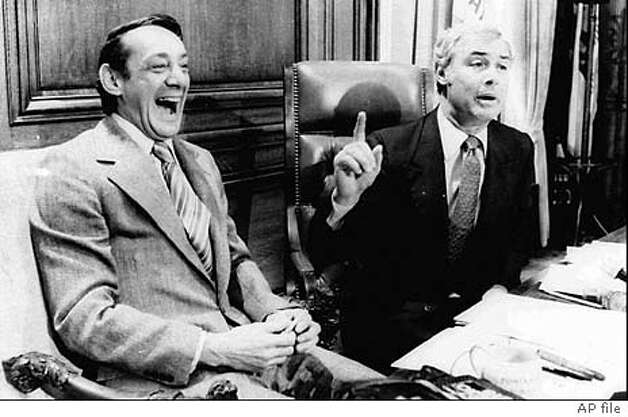 ADVANCE FOR NOV. 27 - FILE - San Francisco Supervisor Harvey Milk, left, and Mayor George Moscone are shown in April 1977 in the mayor's office during the signing of the city's gay rights bill. Friday, Nov. 27, 1998, marks the 20th anniversary of the assassination of Milk and Moscone. (AP Photo/File) ALSO RAN: 12/09/1999