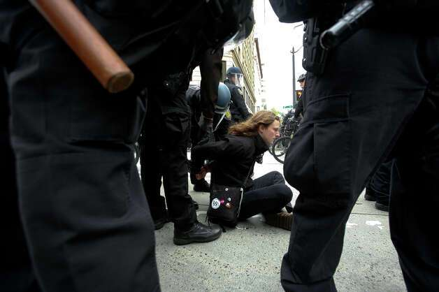 A protester is arrested during the May Day rally in Westlake park in Seattle on Tuesday, May 1, 2012. Photo: SOFIA JARAMILLO / SEATTLEPI.COM