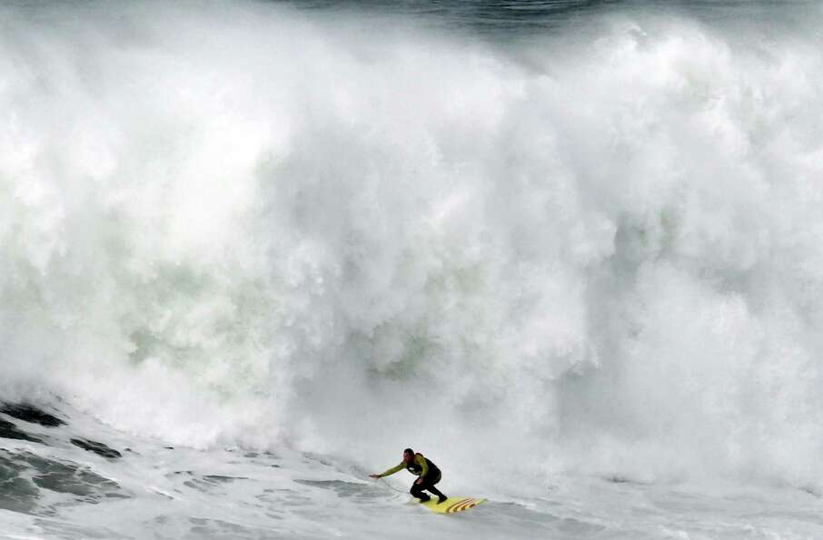 Surfer Rides 100 Ft Wave Portugal