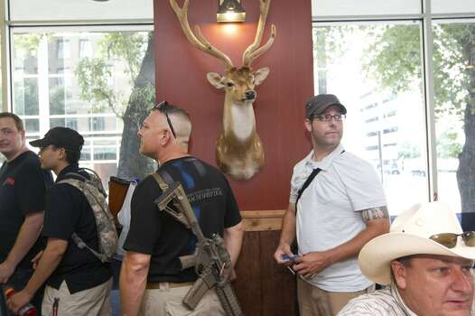 "After walking with their guns through downtown as part of a pro-gun rally, the group of about 25 people with the organization, Come and Take it Houston, ate lunch at Tony's BBQ & Steak House, which they said was a gun-friendly establishment Thursday, July 4, 2013, in Houston.<br /><br /><br /> ""This is a Come and Take it Houston walk to help inform citizens about the gun laws here in Texas,"" co-orginizer Kenneth Lindbloom said. ""In Texas there are no restrictions on the open cary of long arms like rifles and shotguns and we want people to realize that in the hands of good people, guns are not dangerous and they don't kill people. When good people have guns it serves as a deterrent to stop crime.""( Johnny Hanson / Houston Chronicle ) Photo: Houston Chronicle"