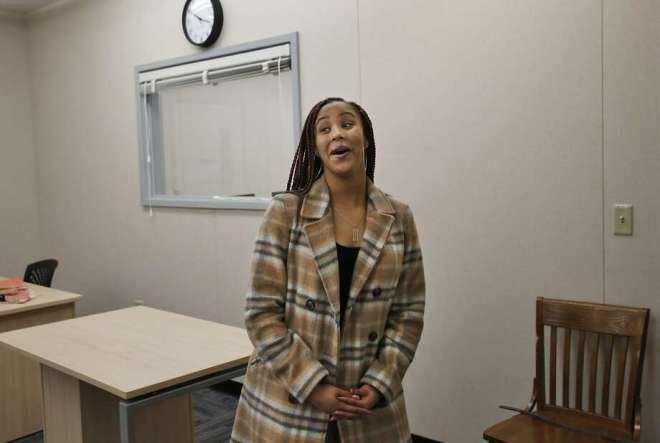 Tia Dunbar, 18, takes a look around on a mini-tour from Corey Hill, the College and Career Readiness Specialist as she is filmed by Melhik Hailu of ONews for a feature on Dunbar at Oakland High School's brand new Future Center Jan. 26, 2016 in Oakland, Calif. The Center is part of the Oakland Promise Initiative, which is striving to double the number of college graduates in the city within the next eight years. Photo: Leah Millis, The Chronicle