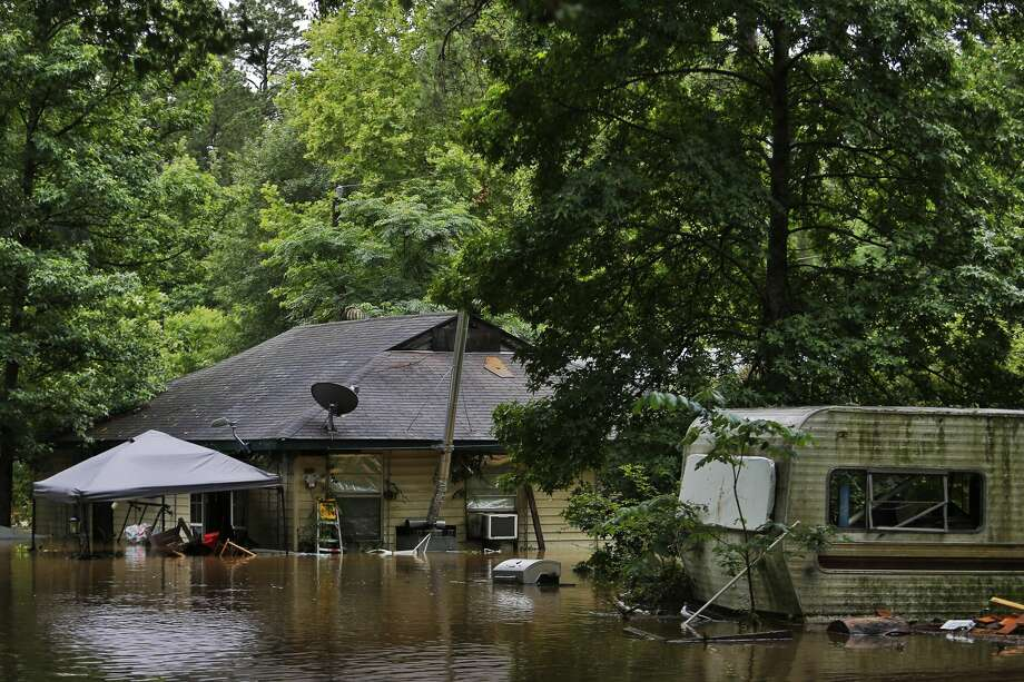 Homes in a neighborhood off Mill Creek in Magnolia sit underwater after heavy storms. Photo: Michael Ciaglo
