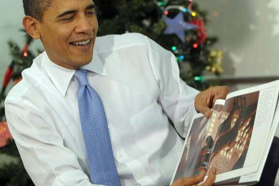 "President Barack Obama reads ""The Polar Express"" to children at the Boys and Girls Club of Washington in December 2009."