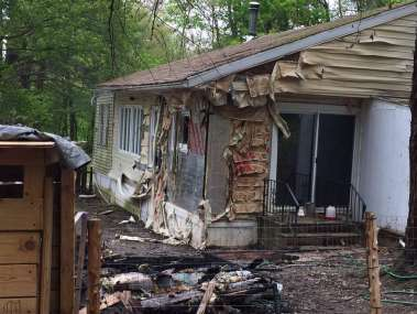 A black family woke up Sunday night to find their detached garage sprayed with hateful graffiti and engulfed in flames, Schodack Police Chief Joseph Belardo said Monday, May 15, 2017.The parents and their five children— who are all under the age of 10— were physically unharmed but emotionally traumatized by the fire set at 29 Cold Spring Ave., the chief said.(Robert M. Gavin/Times Union) Photo: Robert Gavin