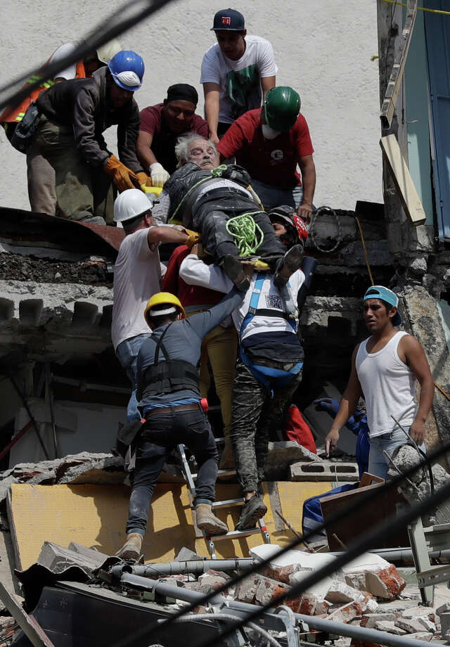 An injured man is pulled out of a building that collapsed during an earthquake in Mexico City, Tuesday, Sept. 19, 2017. A powerful earthquake jolted central Mexico on Tuesday, causing buildings to sway sickeningly in the capital on the anniversary of a 1985 quake that did major damage. Photo: Rebecca Blackwell, AP / Copyright 2017 The Associated Press. All rights reserved.
