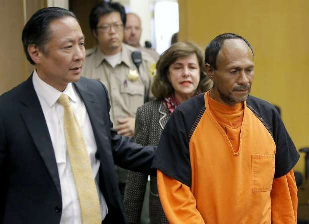 FILE - In this July 7, 2015 file photo, Jose Ines Garcia Zarate, right, is led into the courtroom by San Francisco Public Defender Jeff Adachi, left, and Assistant District Attorney Diana Garciaor, center, for his arraignment at the Hall of Justice in San Francisco. Photo: Michael Macor, San Francisco Chronicle