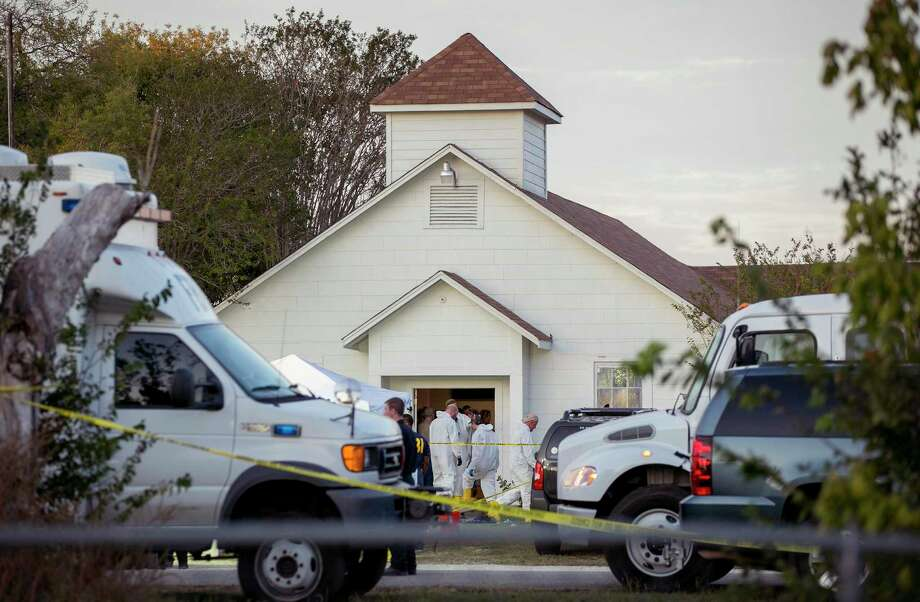 Investigators work at the scene of a mass shooting at the First Baptist Church in Sutherland Springs, Texas, on Sunday Nov. 5, 2017. A man opened fire inside of the church in the small South Texas community on Sunday, killing more than 20 people.(Jay Janner/Austin American-Statesman via AP)/Austin American-Statesman via AP) Photo: Jay Janner, MBO / Austin American-Statesman