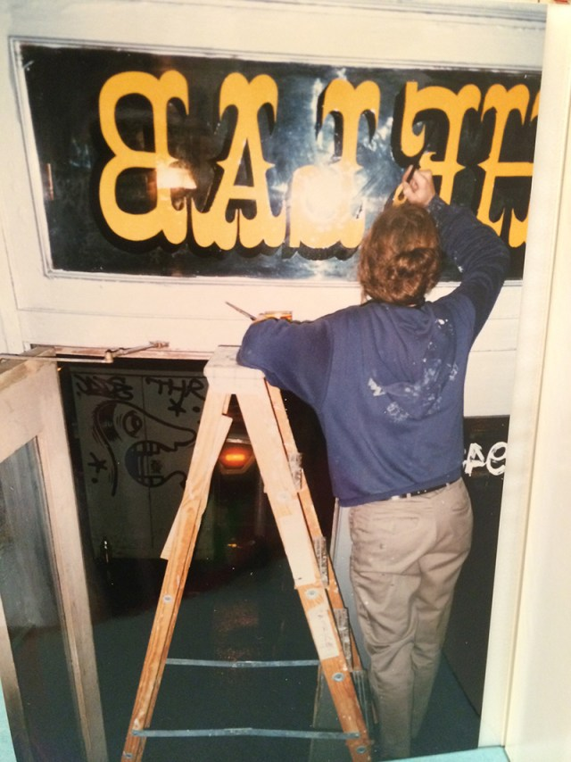 Margaret Kilgallen painting window signage at The LAB, February 1997. Courtesy of Barry McGee.