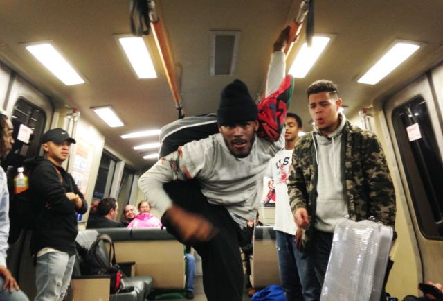 """""""Krow"""" the dancer shows his moves on a BART train"""