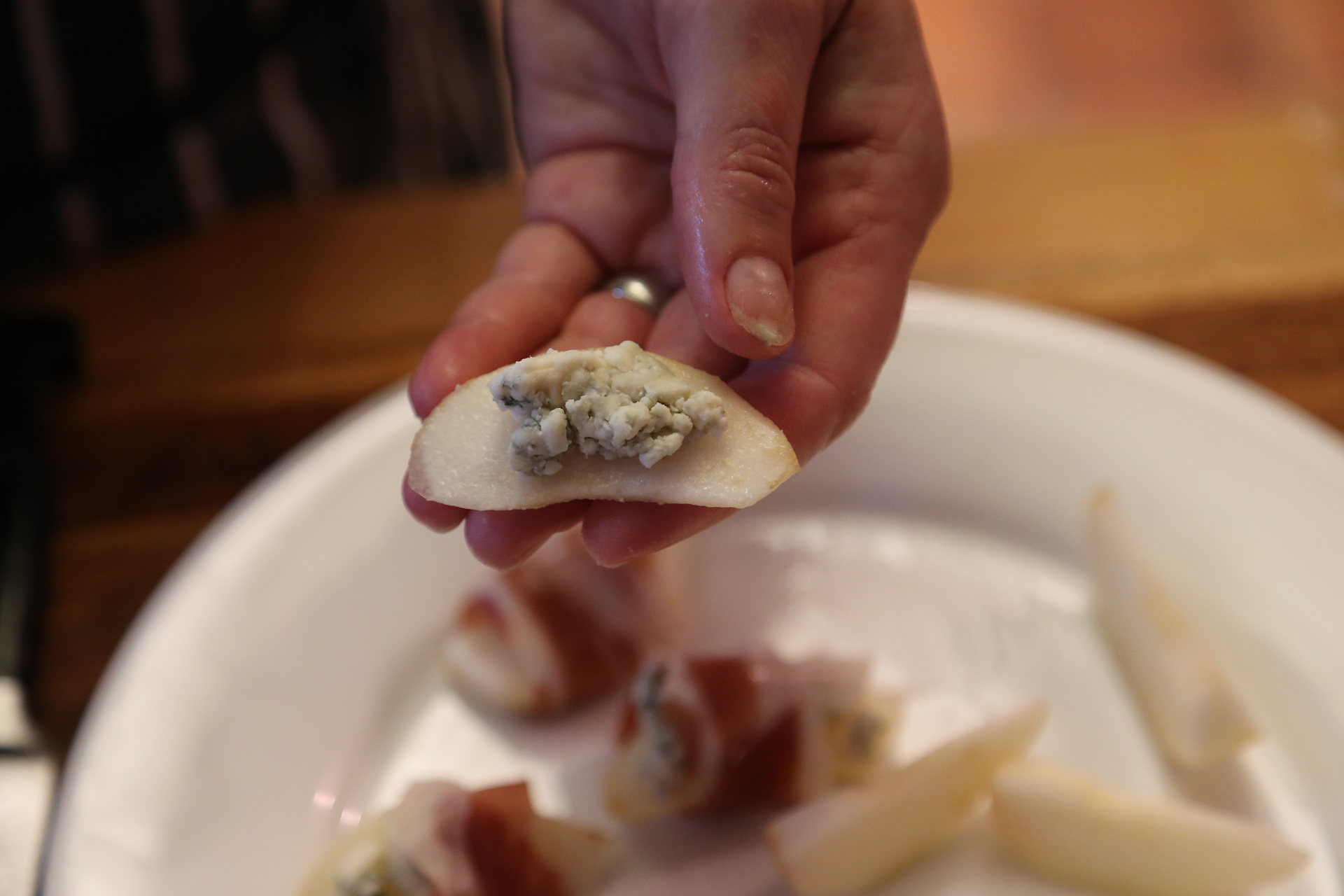 On each pear slice, press 1 tsp of blue cheese into a pile.