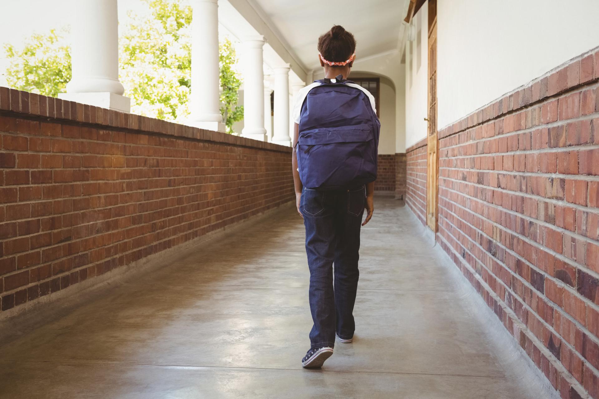 Girl Walking in School Corridor