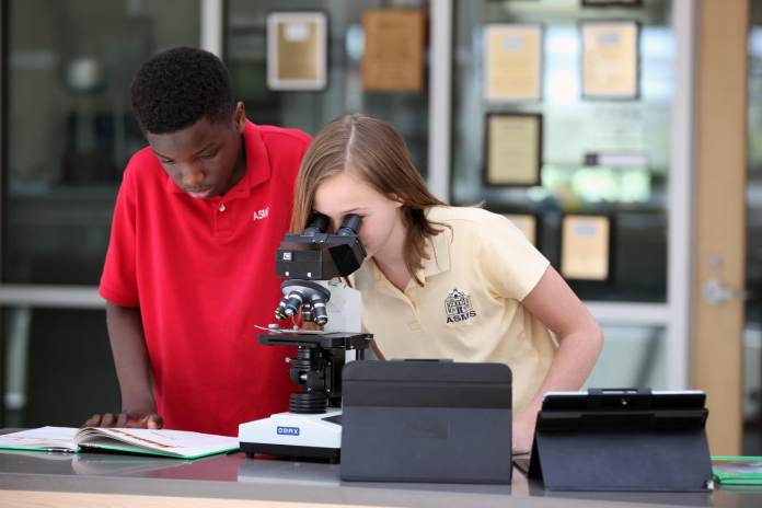 The science curriculum at ASMS encourages students to work collaboratively to solve the road blocks that real scientists face when developing experiments.