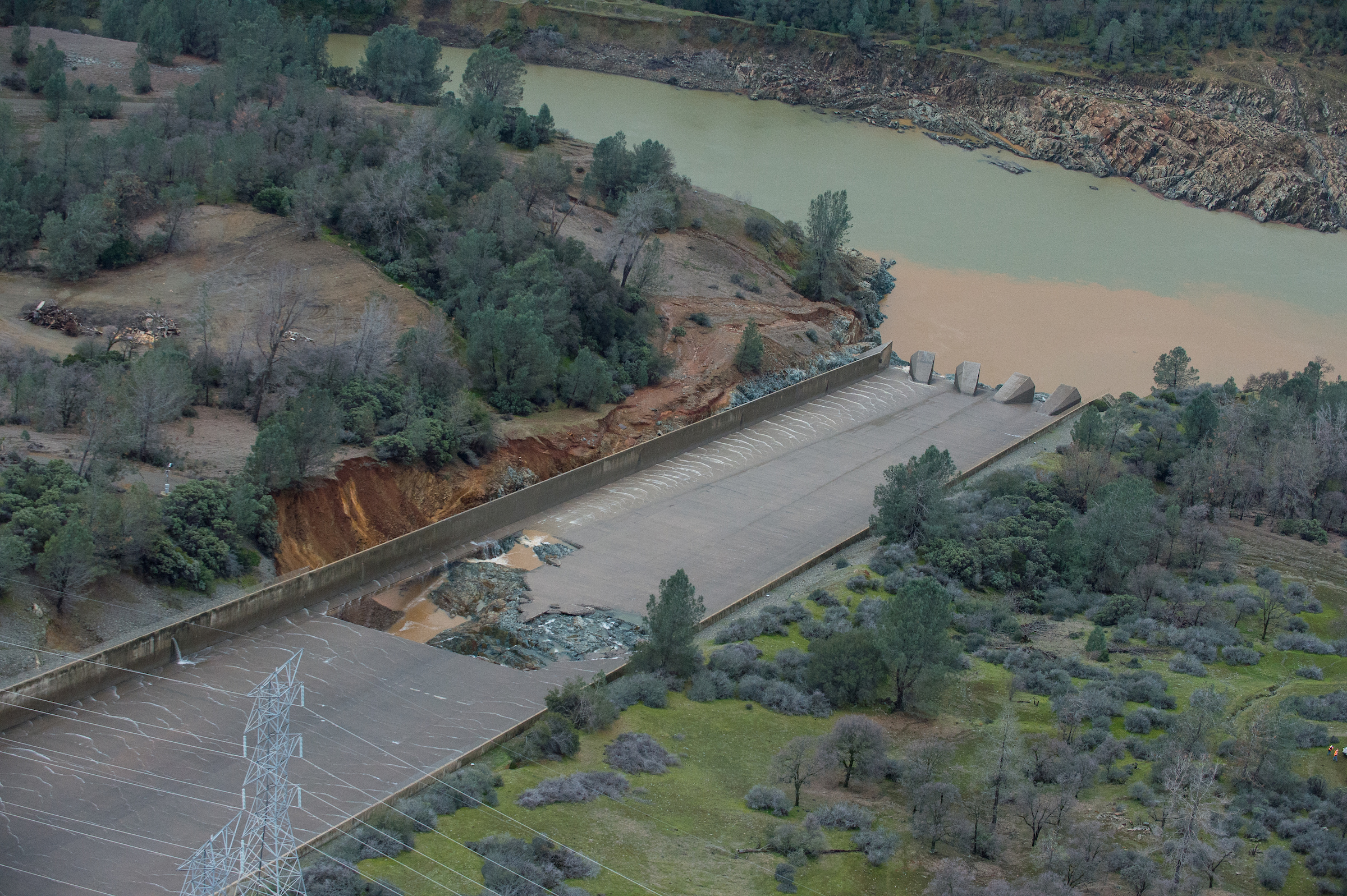 The California Department of Water Resources has suspended flows from the Oroville Dam spillway after a concrete section eroded on the middle section of the spillway. There is no anticipated threat to the dam or the public. DWR engineers are assessing the options to repair the spillway and control the reservoir water level. The Butte County facility is the tallest dam in the United States at 770 feet and is a key part of the State Water Project. Photo taken February 7, 2017. Kelly M. Grow/ California Department of Water Resources