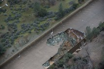 California Department of Water Resources photos taken Tuesday, Feb. 7, 2017, show extensive damage to the Oroville Dam spillway and severe erosion to area adjacent to spillway structure.