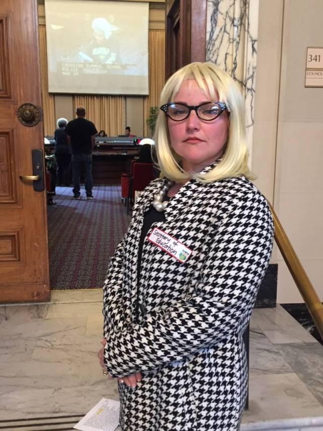 Kaiser Elementary parent Alicia Johnson dressed up as U.S. Secretary of Education Betsy DeVos for an anti-charter school skit