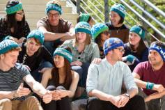 Stanford students wearing knitted hats created for the March for Science, to be held April 22. Designs feature a DNA double helix, lab glassware, a circuit with a battery and three resistors, a space shuttle, wind turbines and others.