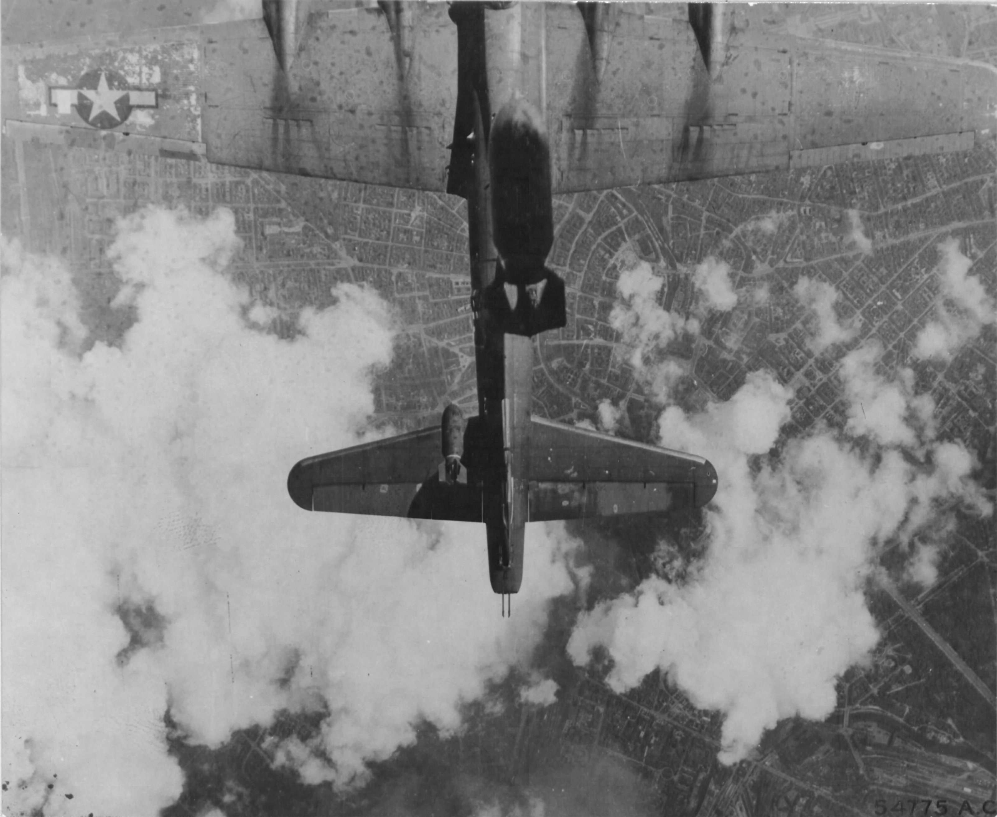 B-17G Fortress 'Miss Donna Mae II' drifted under another bomber on a bomb run over Berlin, 19 May 1944. A 1,000 lb bomb from above tore off the left stabilizer and sent the plane into an uncontrollable spin. All 11 were killed. Photo 1 of 4