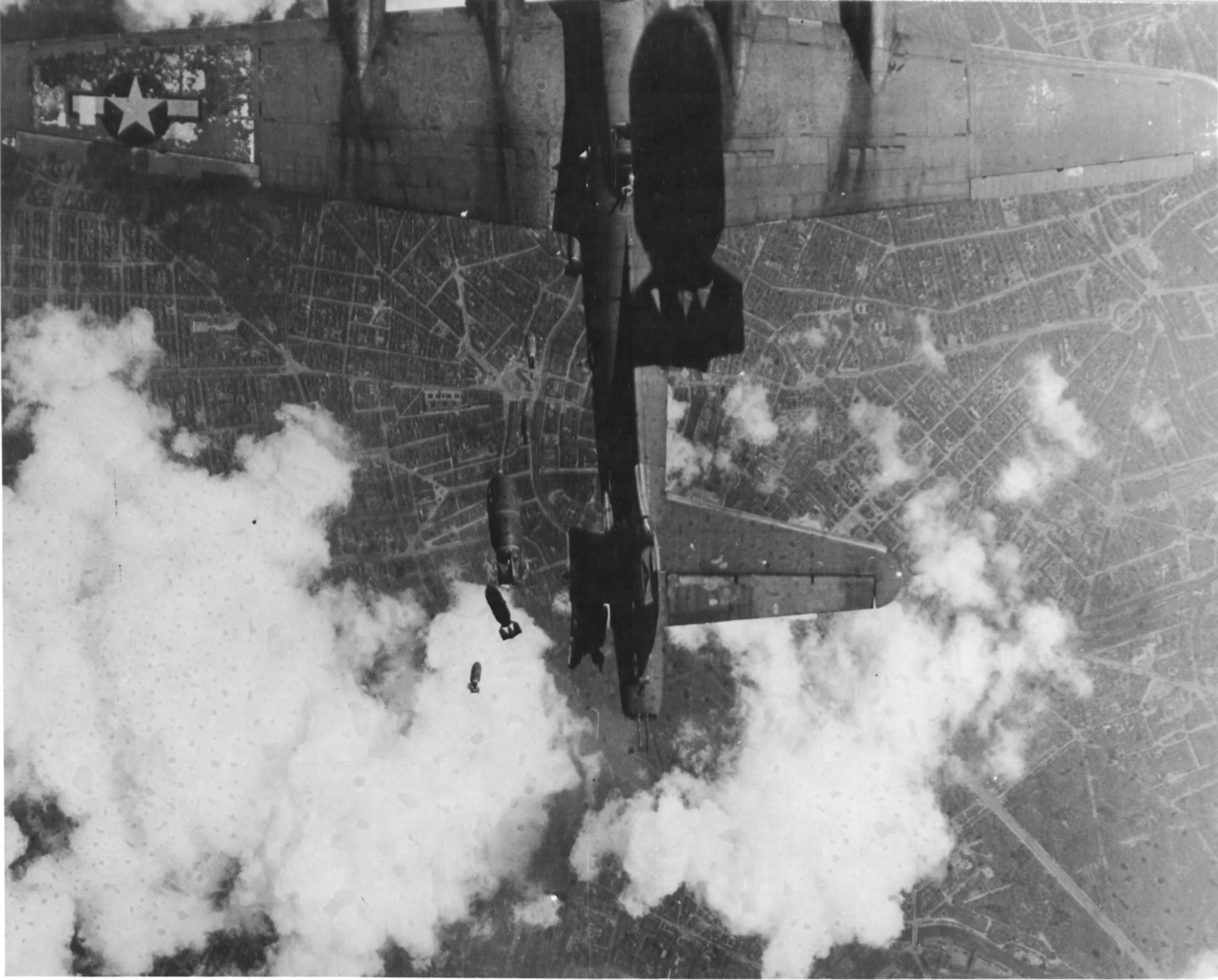 B-17G Fortress 'Miss Donna Mae II' drifted under another bomber on a bomb run over Berlin, 19 May 1944. A 1,000 lb bomb from above tore off the left stabilizer and sent the plane into an uncontrollable spin. All 11 were killed. Photo 2 of 4