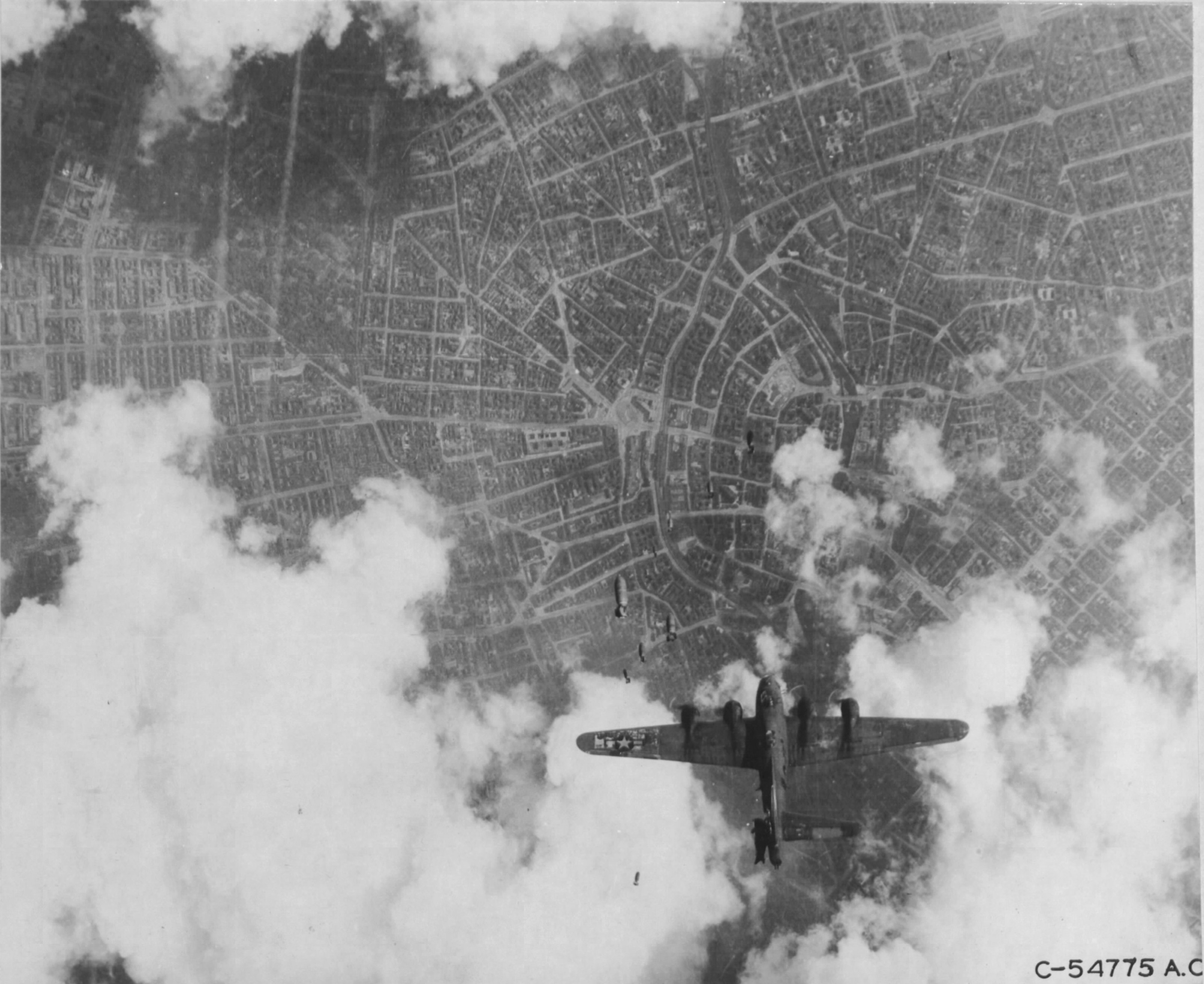 B-17G Fortress 'Miss Donna Mae II' drifted under another bomber on a bomb run over Berlin, 19 May 1944. A 1,000 lb bomb from above tore off the left stabilizer and sent the plane into an uncontrollable spin. All 11 were killed. Photo 4 of 4