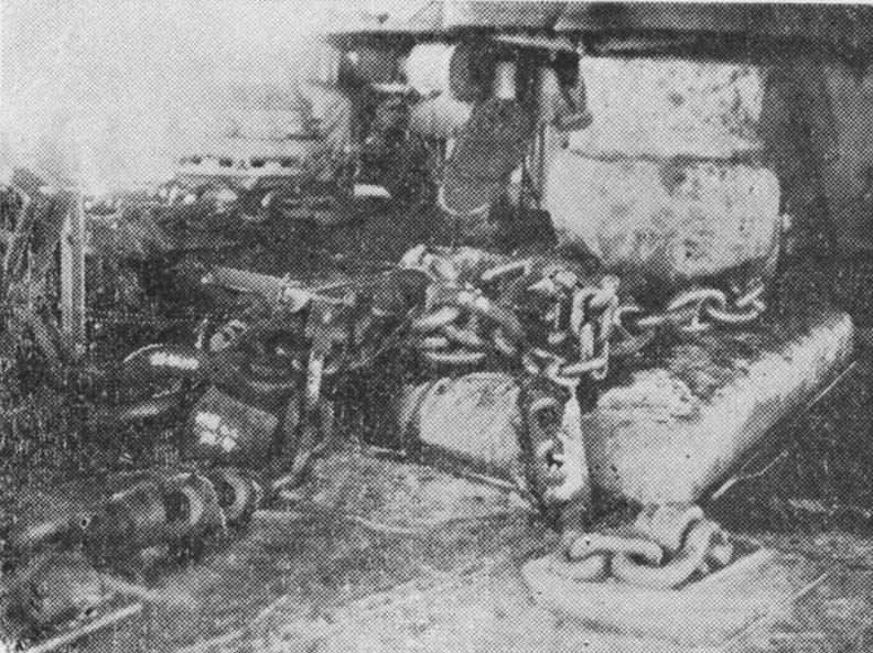 View of damaged anchor chains of Shokaku, cut by the first bomb hit received at the Battle of the Coral Sea, Kure, Japan, between 17 May and 27 Jun 1942