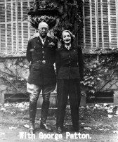 Paris, France --- 5/1945- Paris, France: General George Patton and Marlene Dietrich. Marlene is wearing an army uniform, and Patton is frowning. --- Image by © Bettmann/CORBIS