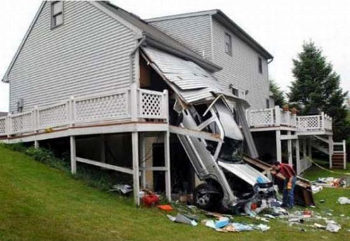 Car Crashes Through Garage