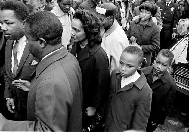 Family members and friends of the assassinated civil rights leader Dr. Martin Luther King Jr., follow his casket into an Atlanta funeral home after the body arrived from Memphis, on April 5, 1968. From left are: King's brother, the Rev. A.D. Williams King; Dr. Ralph Abernathy, King's close associate and new head of the SCLC, Coretta Scott King, the widow, and her two sons, Martin Luther III, 10,  and Dexter, 7.  (AP Photo/Bill hudson) Photo: BILL HUDSON, STF / Beaumont