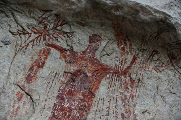 This is a detail of a portion of the mural at the Panther Cave site in Seminole Canyon along the Rio Grande and Lake Amistad. The prehistoric pictographs date back as far as 4,000 years ago. Photo: Billy Calzada, San Antonio Express-News / San Antonio Express-News