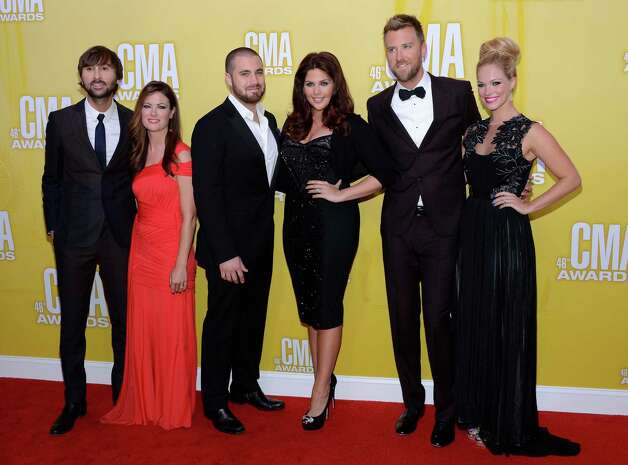 (L-R) Lady Antebellum members Dave Haywood with wife Kelli Cashiola, Hillary Scott (third from right) with husband  Chris Tyrrell (third from left), and Charles Kelley (second from right) with wife Cassie McConnell attend the 46th annual CMA Awards at the Bridgestone Arena on November 1, 2012 in Nashville, Tennessee. Photo: Jason Kempin, Getty Images / 2012 Getty Images