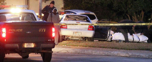 San Antonio police work at the scene Tuesday January 15, 2013 where a suspected burglar was shot and crashed the car he was driving. The suspected burglar was killed and another suspected burglar was shot in the chest by a Stone Oak resident who told police he caught the men breaking into his SUV outside his home near Lightstone Drive and Stonepath Drive about 1:50 a.m. . Photo: JOHN DAVENPORT, San Antonio Express-News / ©San Antonio Express-News/Photo Can Be Sold to the Public