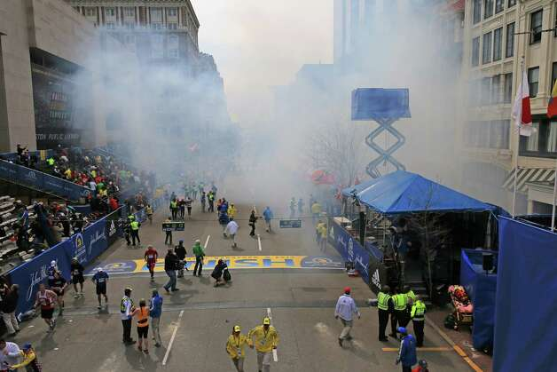 Two explosions went off near the finish line of the 117th Boston Marathon on April 15, 2013. Photo: Boston Globe