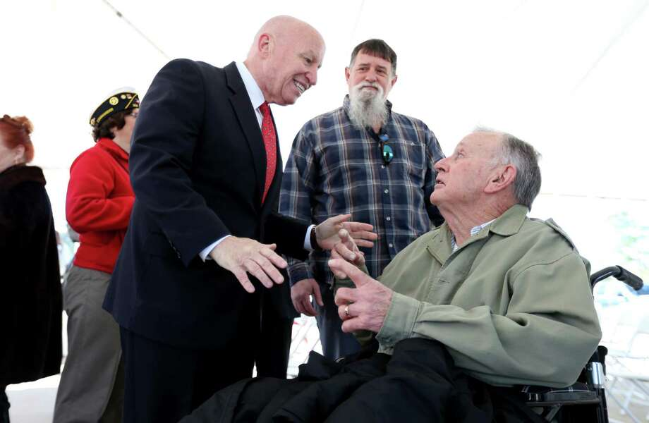 U.S. Rep. Kevin Brady meets with veterans at a ribbon-cutting ceremony for a new Veterans Affairs clinic he helped bring to his district. Photo: Gary Coronado, Staff / © 2015 Houston Chronicle