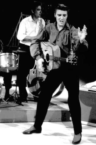 """FILE - In this Sept. 9, 1956 file photo originally released by the Museum of Television & Radio, Elvis Presley performs on the """"Ed Sullivan Show,"""" in New York.  (AP Photo/Museum of Television & Radio, file) Photo: Anonymous, Associated Press / MUSEUM OF TELEVISION & RADIO"""