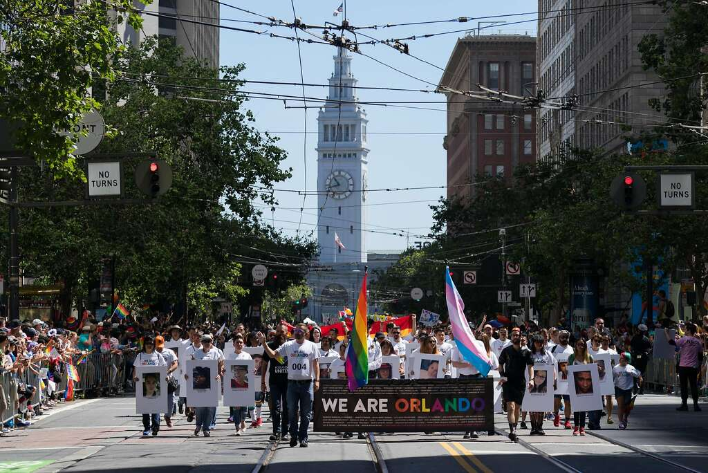 People pay tribute to Orlando during the annual Pride Parade in downtown San Francisco on Sunday, June 26, 2016. The theme for the parade this year is For Racial and Economic Justice. Photo: James Tensuan, Special To The Chronicle