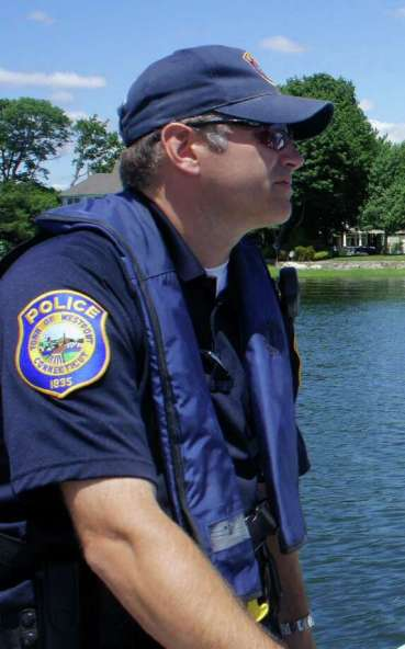 Westport Police Officer Robert Myer, seen here during a July 2011 patrol on the Saugatuck River, died on May 4, 2016 at his home in Newtown, Conn. Photo: Paul Schott / Paul Schott / Westport News