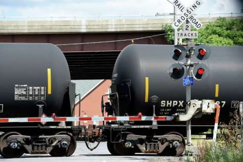 Tank cars head to the siding in the Port of Albany over the port entrance road Wednesday June 29, 2016 in Albany, N.Y.  (Skip Dickstein/Times Union) Photo: SKIP DICKSTEIN