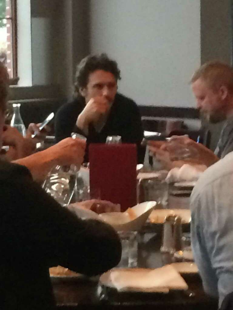 Actor James Franco eats lunch Thursday at Yono's Restaurant in downtown Albany. (Brianna Snyder / Times Union)