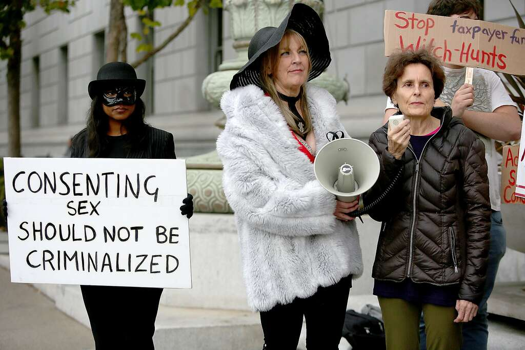 Taylor (left), Erotic Service Providers Union organizer Maxine Doogan (middle), and US Pros and US Prostitutes Collective organizer Rachel West (right) protest the raid on Backpage outside of the California Supreme Court on Tuesday, October 26, 2016, in San Francisco, Calif. Photo: Liz Hafalia, The Chronicle