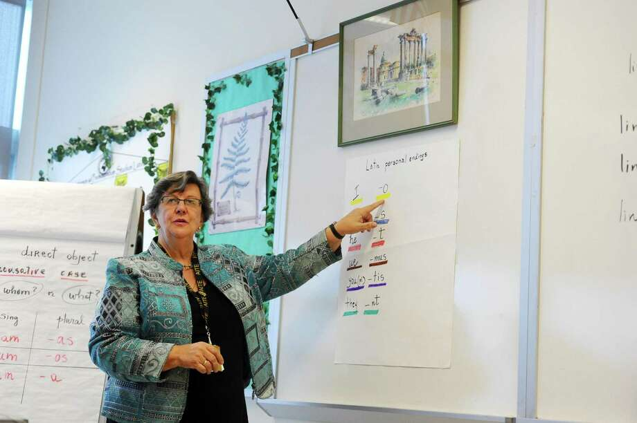 Language teacher Ana Koltypin goes through Latin personal endings during a class at AITE High School in Stamford. Photo: Michael Cummo / Hearst Connecticut Media / Stamford Advocate