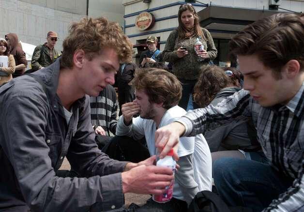 A protesters are treated for pepper spray. Photo: SOFIA JARAMILLO / SEATTLEPI.COM