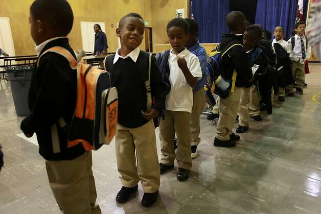 Curtis Dright III, 5, lines up with the rest of his kindergarten class on the first day of school at The 100 Black Men Community School on Tuesday Sept. 04 2012 in Oakland, Calif. Photo: Mike Kepka, The Chronicle / SF