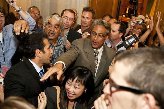 Ross Mirkarimi greets supporters outside the Board of Supervisors' chambers after being reinstated as sheriff. Photo: Jason Henry, Special To The Chronicle / SF