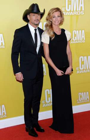 (L-R) Country music artists Tim McGraw and Faith Hill attend the 46th annual CMA Awards at the Bridgestone Arena on November 1, 2012 in Nashville, Tennessee. Photo: Jason Kempin, Getty Images / 2012 Getty Images