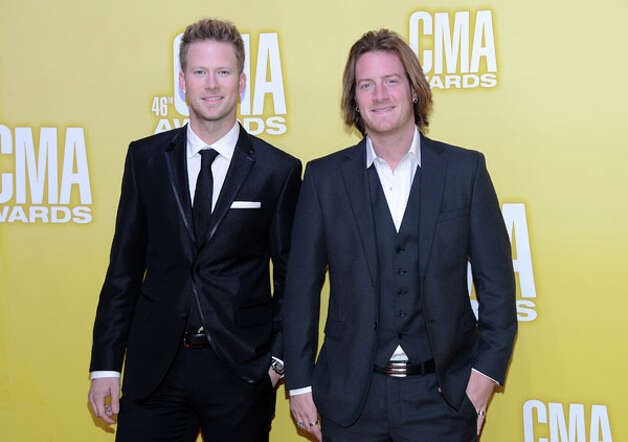 (L-R) Brian Kelly and Tyler Hubbard of Florida Georgia Line attend the 46th annual CMA Awards at the Bridgestone Arena on November 1, 2012 in Nashville, Tennessee. Photo: Jason Kempin, Getty Images / 2012 Getty Images